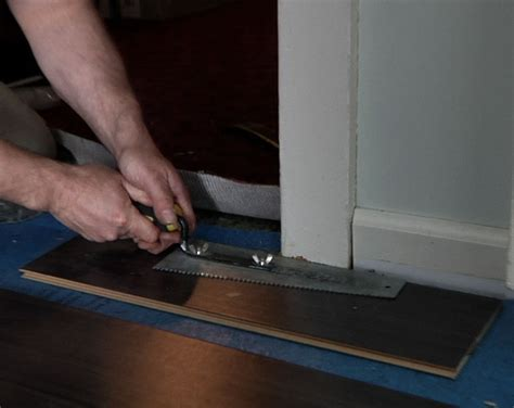 how to install laminate hardwood floors laminate flooring laminate flooring installation through doorways