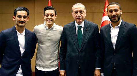 mesut ozil  ilkay gundogan criticised  posing
