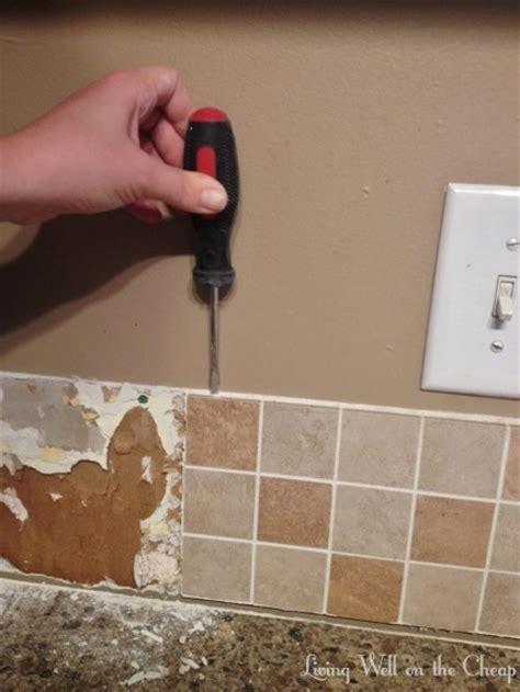 removing kitchen tile backsplash how to remove a tile backsplash living well on the cheap 4710