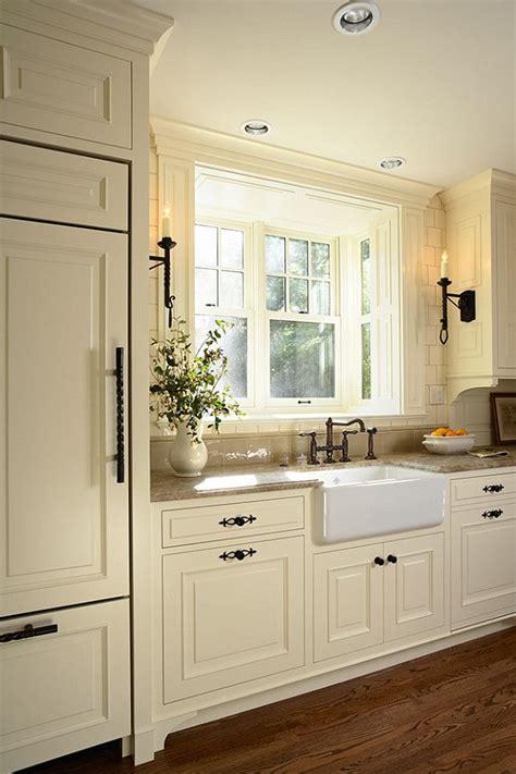 cream white kitchen cabinets   sink