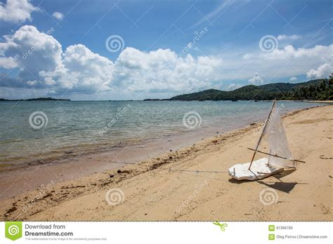 Toy Boat In Sea by Toy Boat At Beach Stock Photography Cartoondealer