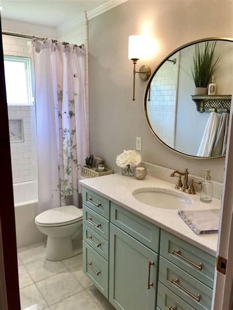 bathroom remodel sea foam green vanity  gold fixtures