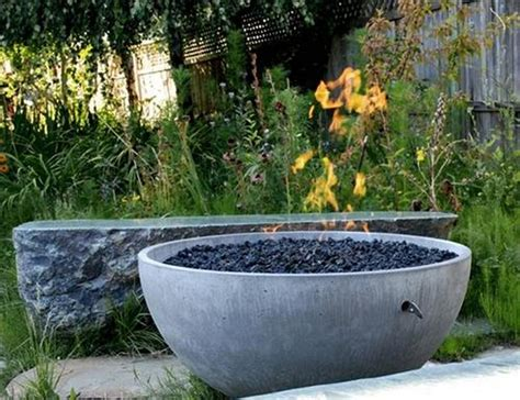 These fire pits are made up of a fiberglass reinforced cement pit and iron frame. DIY Concrete Fire Pit | The Owner-Builder Network
