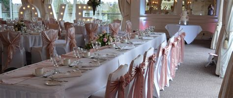 white chair covers with love events signage decor