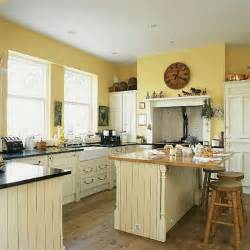 yellow and brown kitchen ideas how about yellow cabinets bad for resale design