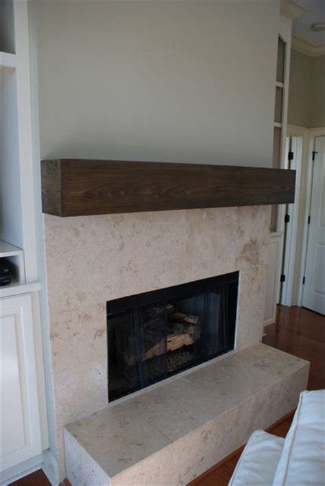 natural stone tile fireplace  wood beam mantel house