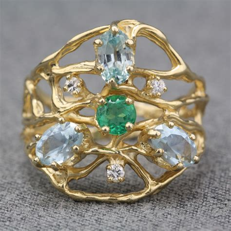 Preowned 14 Karat Yellow Gold Multigemstone Ring. Fine Silver Bracelet. Gold Diamond Anniversary Band. Earring Sapphire. Mens Titanium Bands. Real Sapphire. Wholesale Gemstone Beads. Aquamarine Ring. Fire Diamond