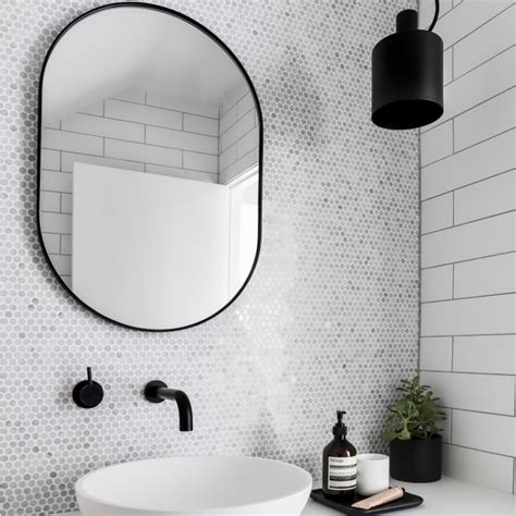 black oval bathroom mirror middle of nowhere bjorn oval mirror black small 17412