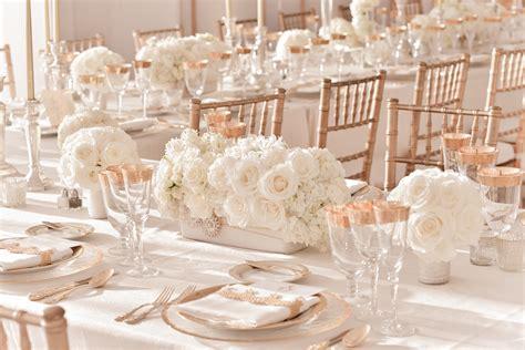 elegant ivory wedding centerpieces  rose gold table