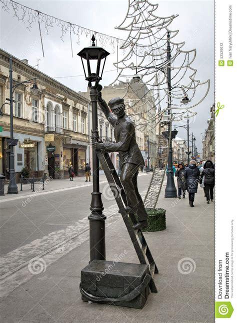 lamplighter lampionaio statue staty lodz av statua redaktionell poland