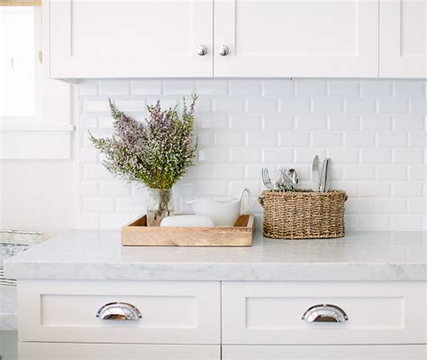 carrara marble subway tile kitchen backsplash inspiring white kitchen with light blue island home