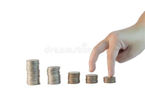 gradino di monete di pile su fondo bianco fotografia stock
