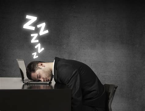 Man-snoozing-at-desk.jpg
