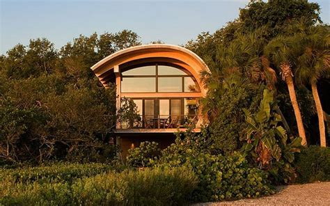 Curved Creation: Fantastic wooden panelled house has a