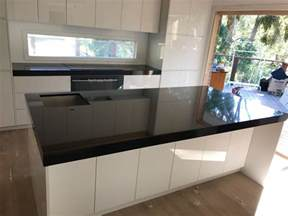 white kitchen island with granite top absolute black granite kitchen benchtop granite