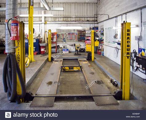 garage hydraulic car lift car repair garage with hydraulic car lift stock photo royalty free image 13460325 alamy