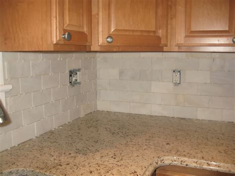 Subway Tile W Cream Cabinets