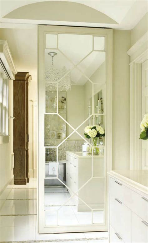 mirrored fret door to closet bathroom