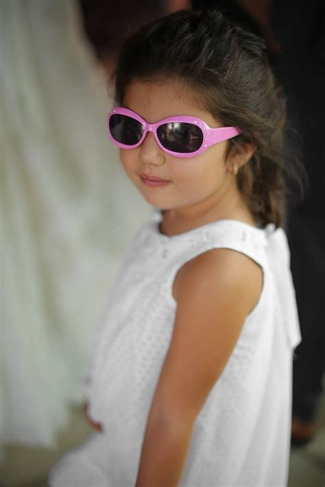 picture girl posing young child sunglasses