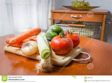 kitchen vegetable cutting table fresh vegetables on cutting board in the kitchen stock