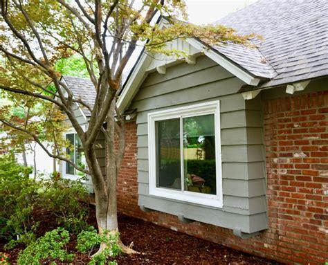 midtown tulsa exterior paint job  yellow door dukes