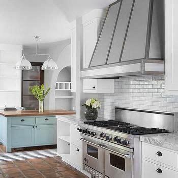 white kitchen  orange terracotta tile floor kitchen