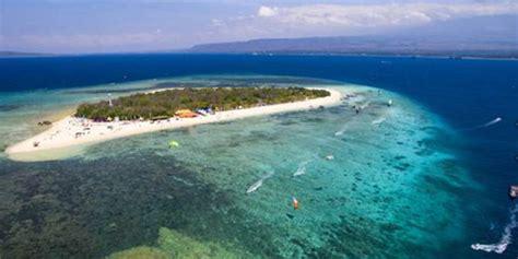 pulau tabuhan tempat selancar layang terbaik  indonesia