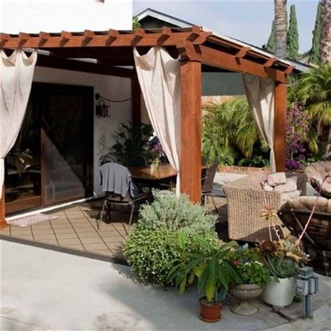 outdoor gazebo pergola with curtains on patio outside spaces