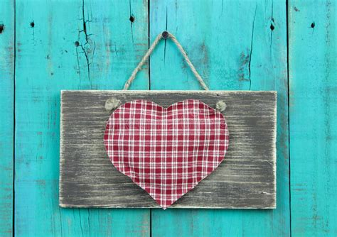 large plaid on rustic sign hanging on vintage teal blue wood door stock photo image