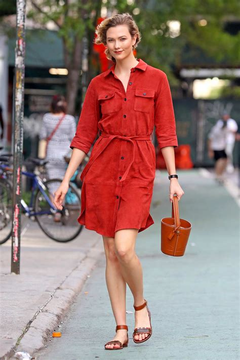 Karlie Kloss Looks Striking Red Button Dress