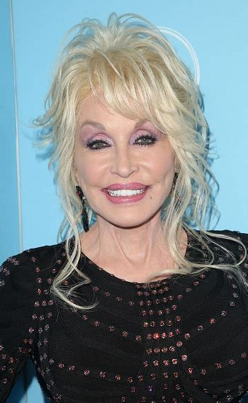 hairstyles dolly parton wispy updo