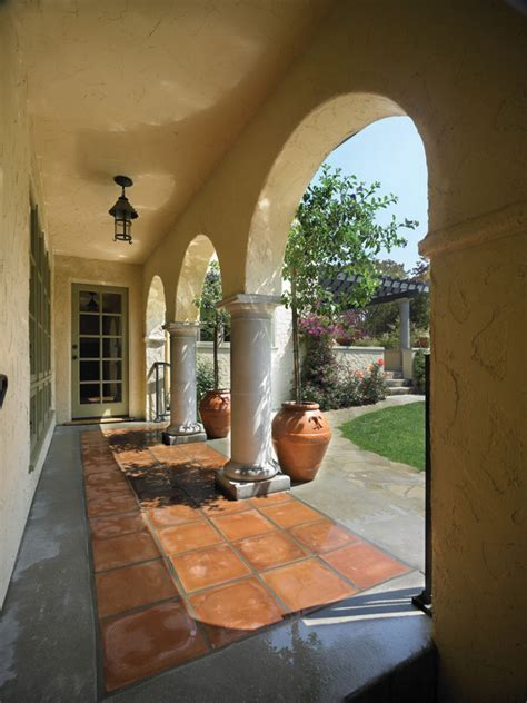 terra cotta tile Entry Eclectic with beamed ceiling cozy