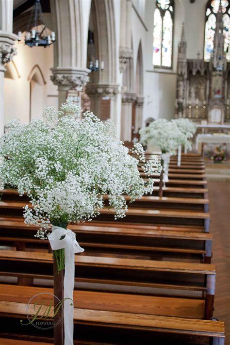 flower stands decorated  gypsophila church wedding