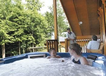 Forest Lodge With Tub by Bulworthy Forest Lodges In Fishing Holidays