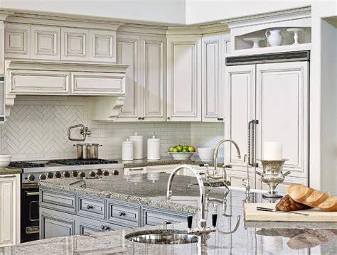 shaped blue kitchen island  gray granite countertops