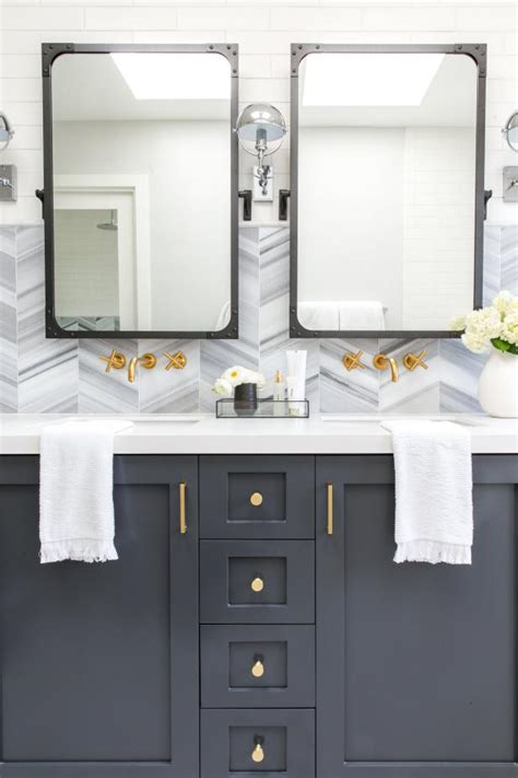 blue  gray wall vanity  brass faucets