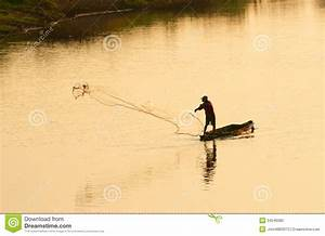 A Man Throw Fishing Net In Evening Stock Photography ...