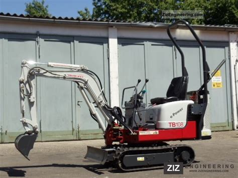 takeuchi tb  hybrid electric excavator   hours  minikompact digger construction