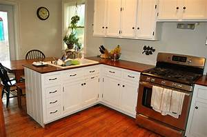 L shaped brown painted wooden kitchen cabinets modern for Kitchen colors with white cabinets with wooden fish wall art