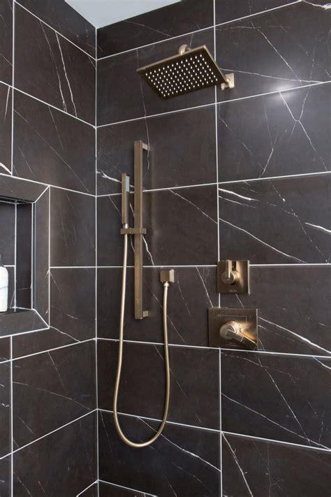 modern shower  black marble tiles  gold fixtures hgtv