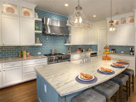 white kitchen cabinets  blue subway tile backsplash
