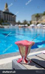 Melting Ice Cream On A Table Near Pool Stock Photo 194776310 : Shutterstock