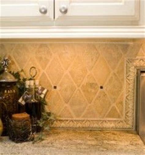 lowes kitchen floors 25 best ideas about travertine backsplash on 3877