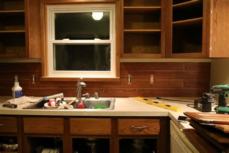 pictures of kitchens with white cabinets and black countertops faux shiplap backsplash with peel n stick flooring 9945