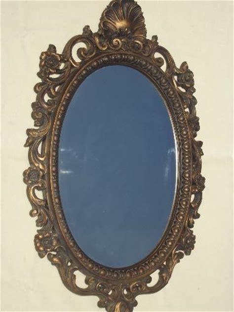 ornate antique gold plastic framed glass hall mirror