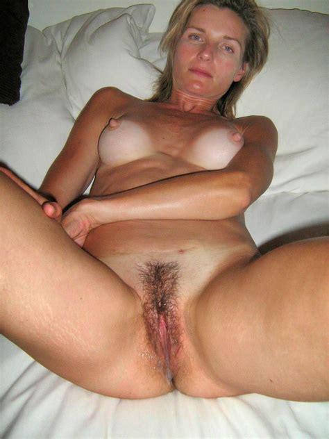 nude mature women in bed