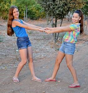 Two best friend girls holding hands — Stock Photo © dnaveh ...