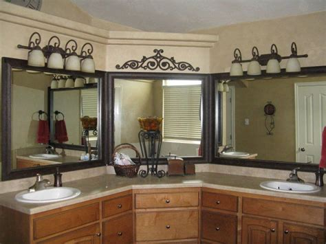 Bathroom Mirror Frame Kits by Frame Those Mirrors And Hide The Unsightly Seam