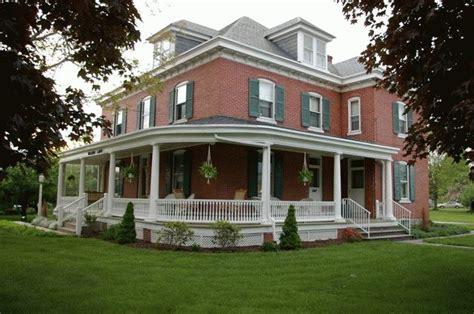 wrap  porch  red brick home pinterest