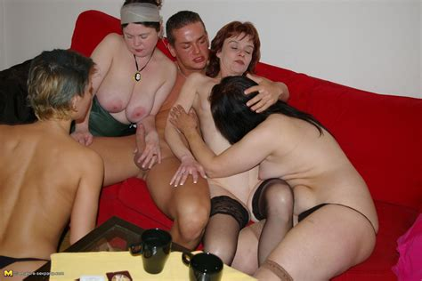 loads of horny mature sluts sharing one single cock at this mature sexparty